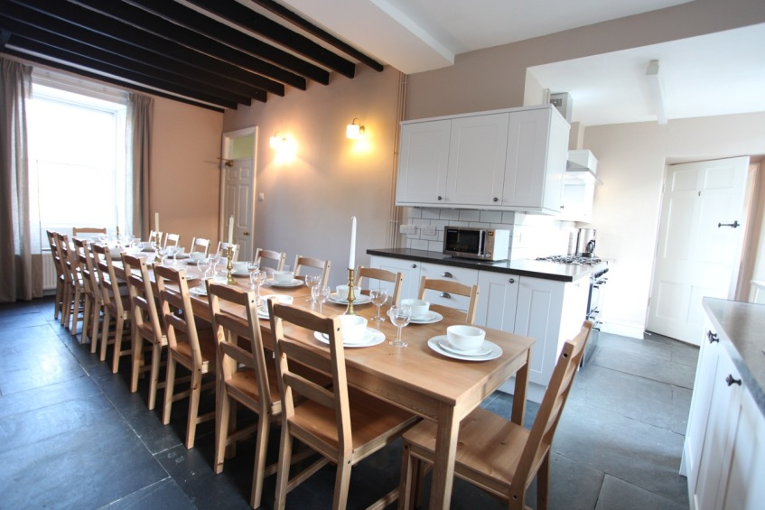 The kitchen and dining area (set for 18)
