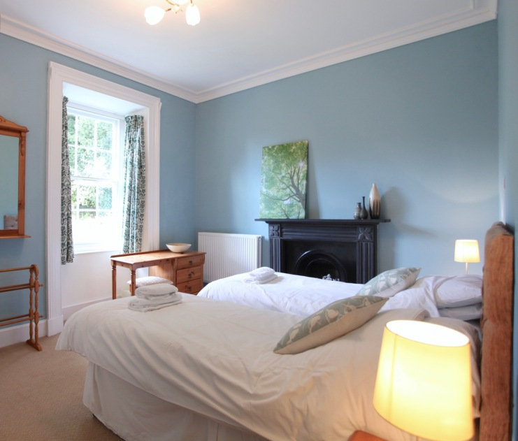 Two single beds with view of private garden