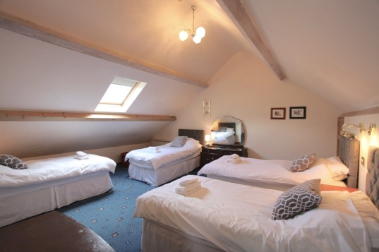 Second floor bedroom: Four single beds with vaulted ceiling and exposed beams