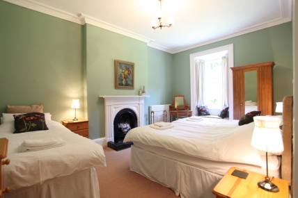 Second bedroom: Three single beds and garden view